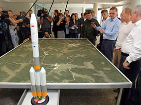 Russian Prime Minister Vladimir Putin, second right,  looks at a plan while  visiting a site of a new launch facility, cosmodrome Vostochny, outside Uglegorsk, some 3,600 miles (5800 kilometers) east of Moscow, Russia, Saturday, Aug. 28, 2010. Russia will be launching its manned space missions from a new launching pad in the Far East in 2018 as the country seeks greater independence in its space program. Putin made the announcement on Saturday as he unveiled a monument marking the start of the cosmodrome construction in the town of Uglegorsk. (AP Photo/RIA-Novosti, Alexei Druzhinin, Pool)